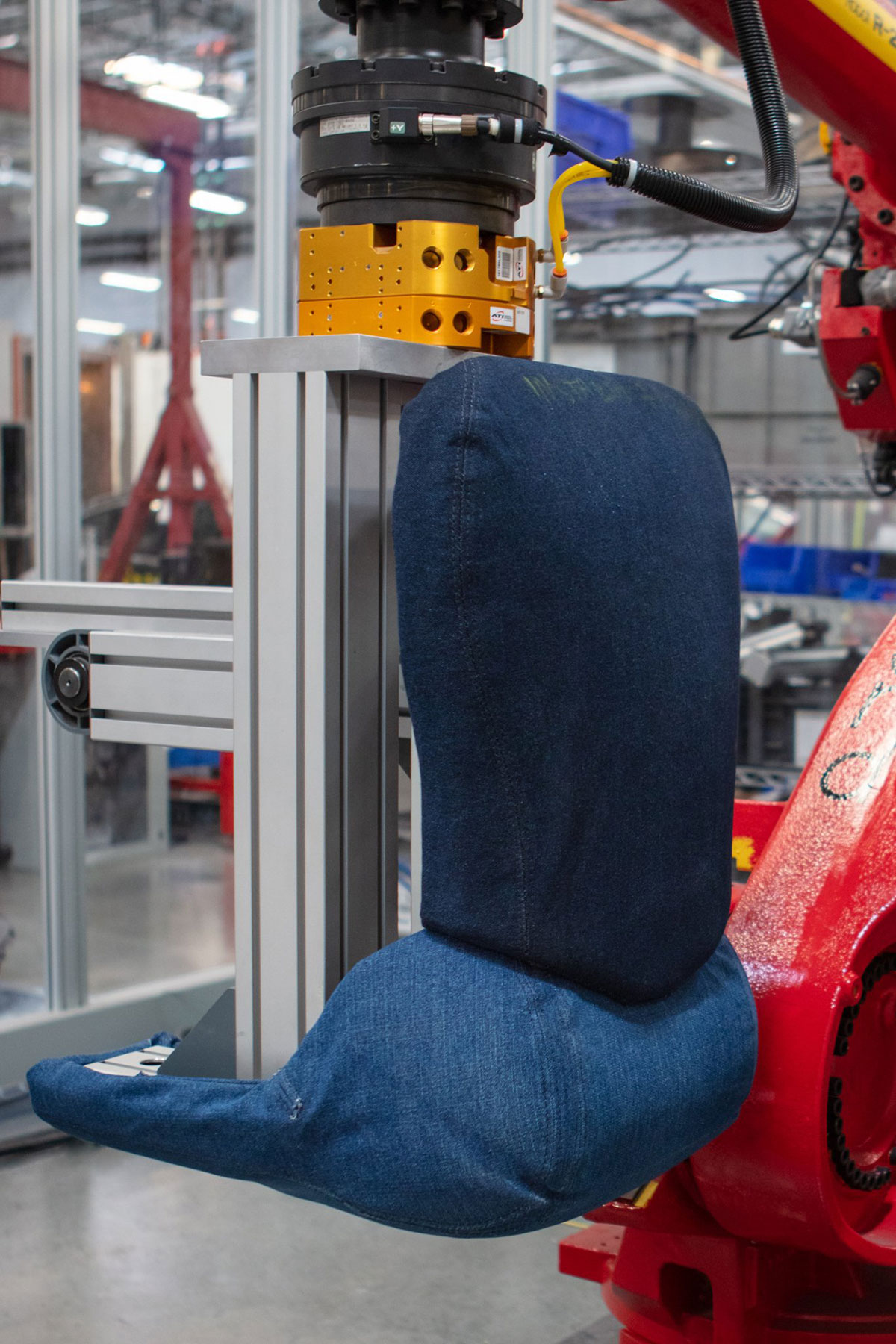 Tesla Model 3 seat tester model wearing blue jeans for stain resistance testing.