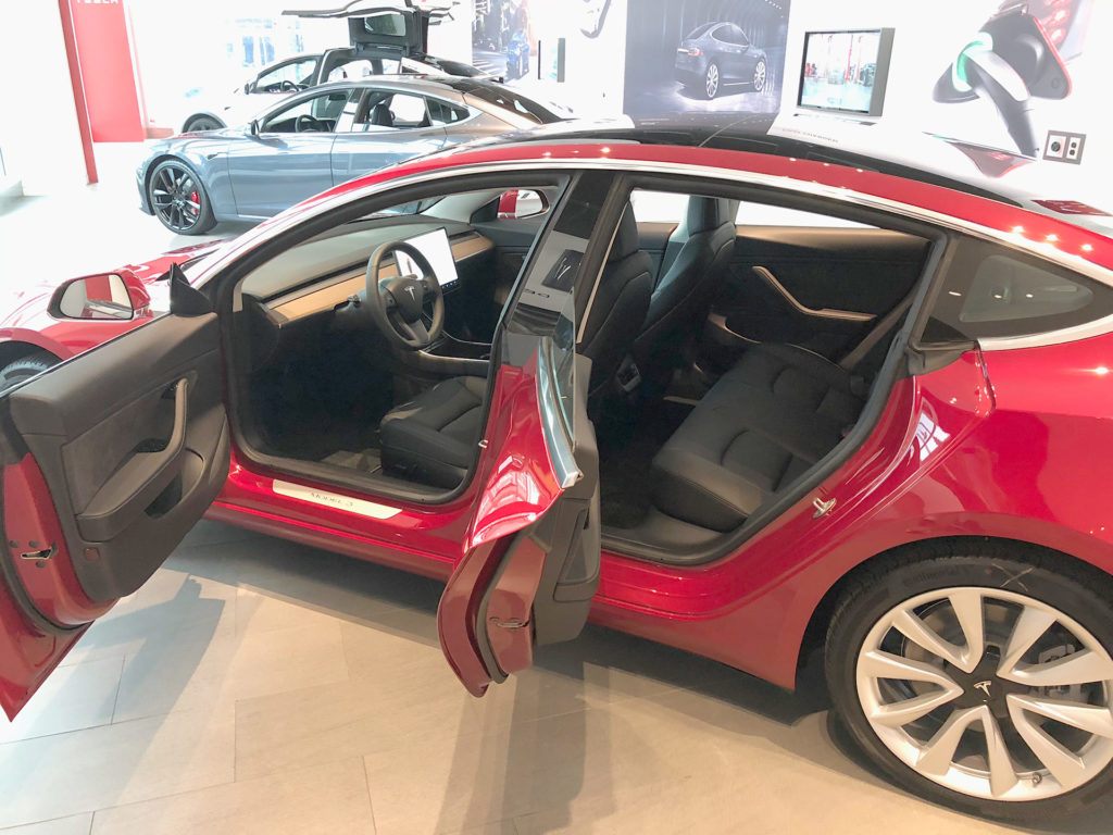 Red Tesla Model 3 at the Jacksonvlle, FL Tesla Store ready for delivery - Doors Open