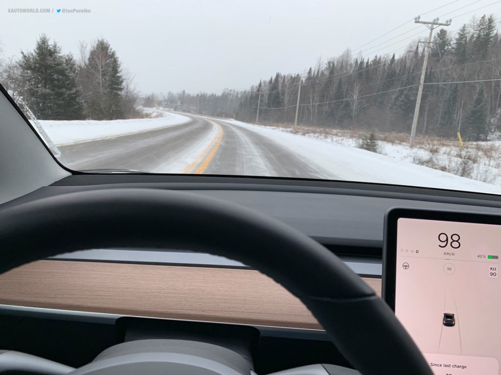 Tesla Model 3 Performance snow rally race - photo from inside the car of the road ahead