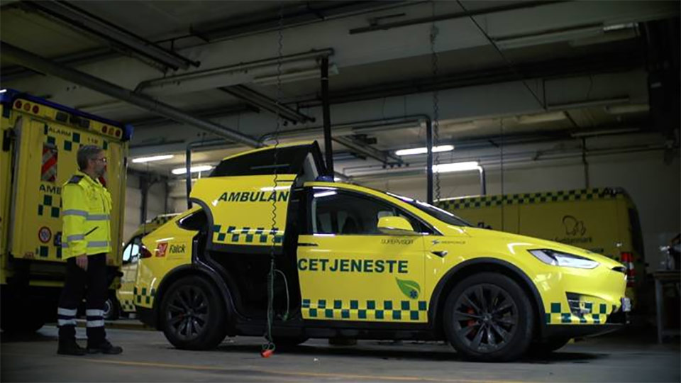 Tesla Model X ambulance from Denmark by Falck - Side View with falcon wing doors
