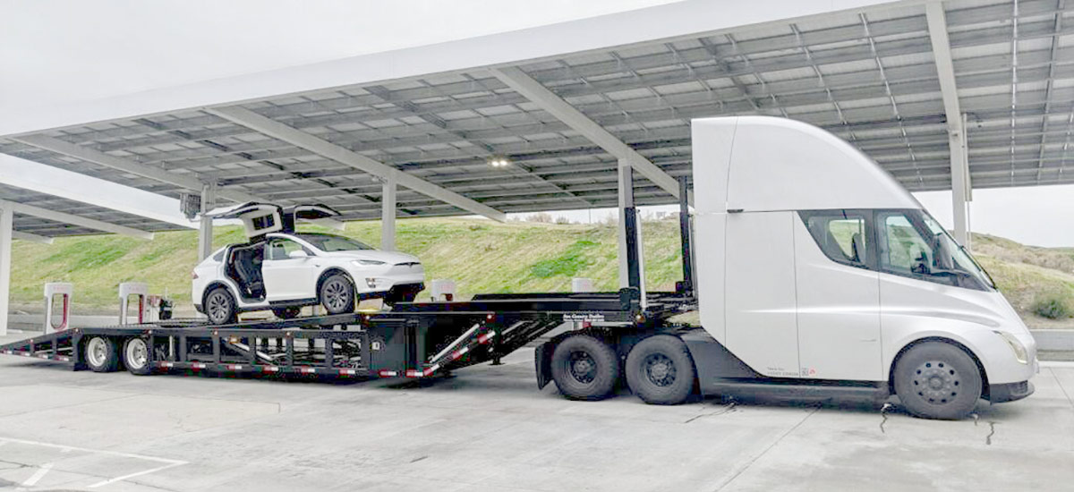 Tesla Semi Truck carrying a Tesla Model X on empty trailer