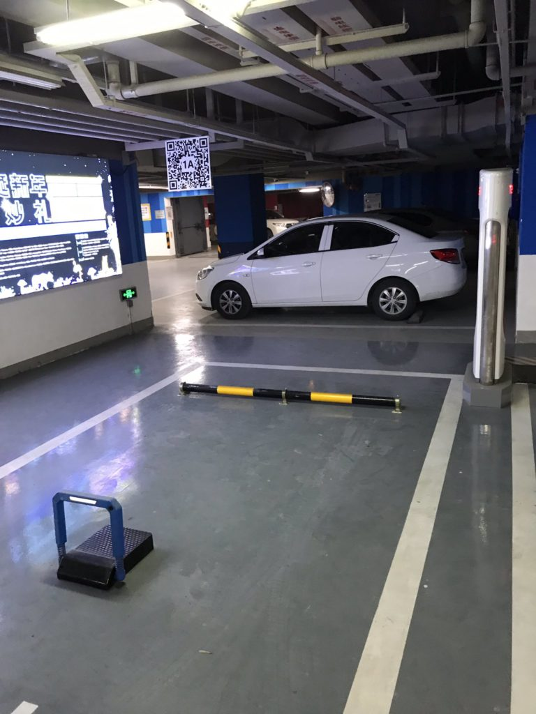 Tesla Superchargers in China with ICE vehicle blockers