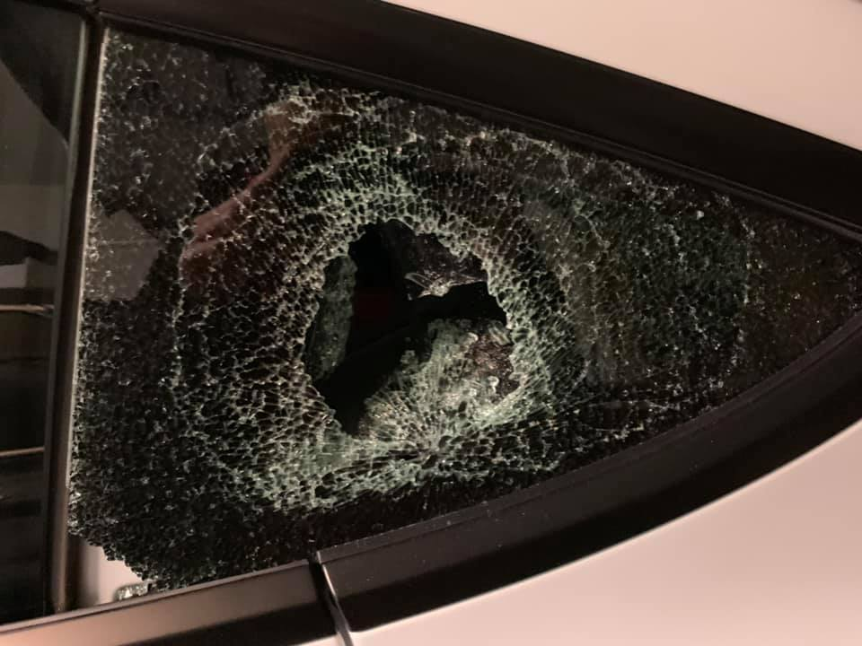 Tesla Model rear quarter window break-in closeup shot