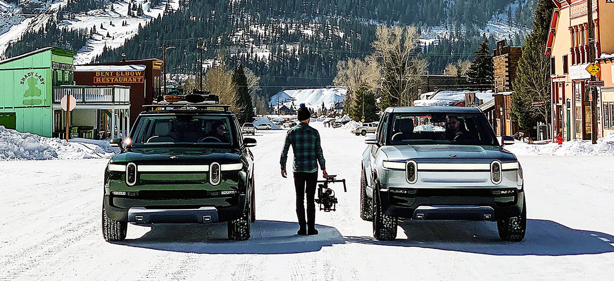 Rivian R1S SUV and R1T Pickup Truck prototypes on an electric adventure in snowy mountains