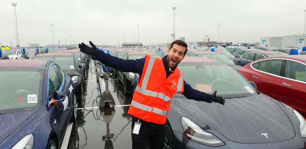 Tesla Model 3 electric cars charging at the Port Of Zeebrugge, Belgium.