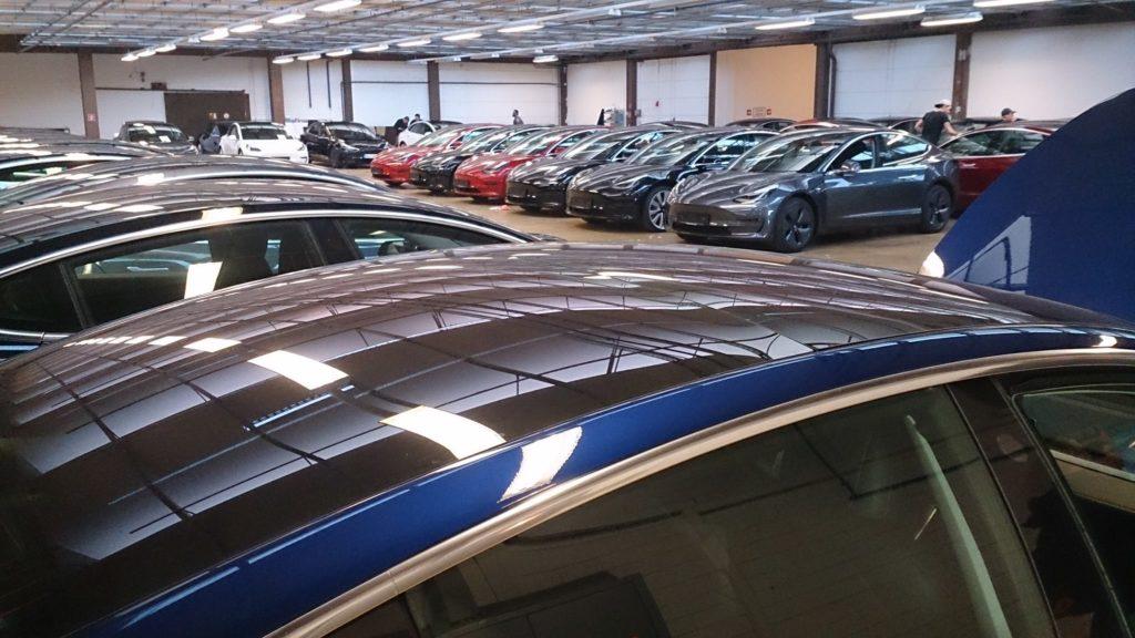 Tesla Store in Frankfurt Germany filled with Tesla Model 3 electric sedans.