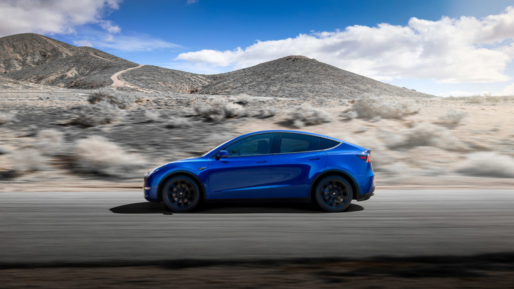 Tesla Model Y in blue color, side view