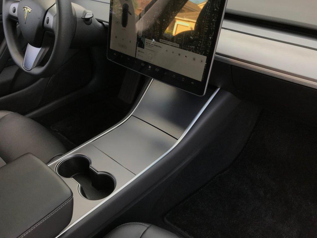 EVANNEX Model 3 center console wrap in gunmetal
