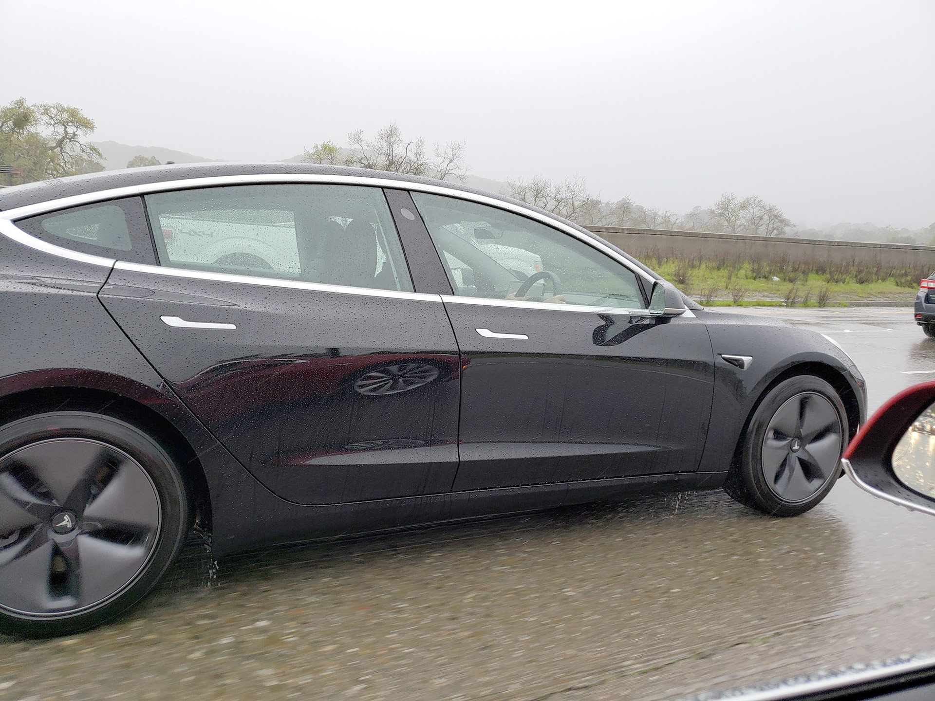 First Right-Hand-Drive Tesla Model 3 spotted - Dual Motor, Aero Wheels, Black Color