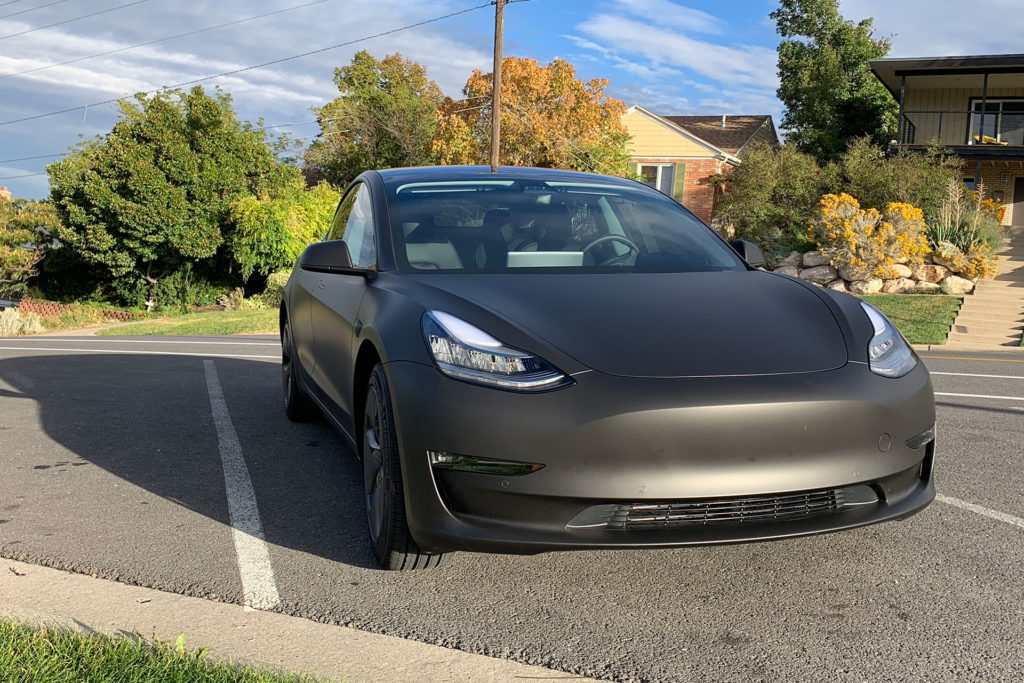 Tesla Model 3 wrapped in matte black, front fascia