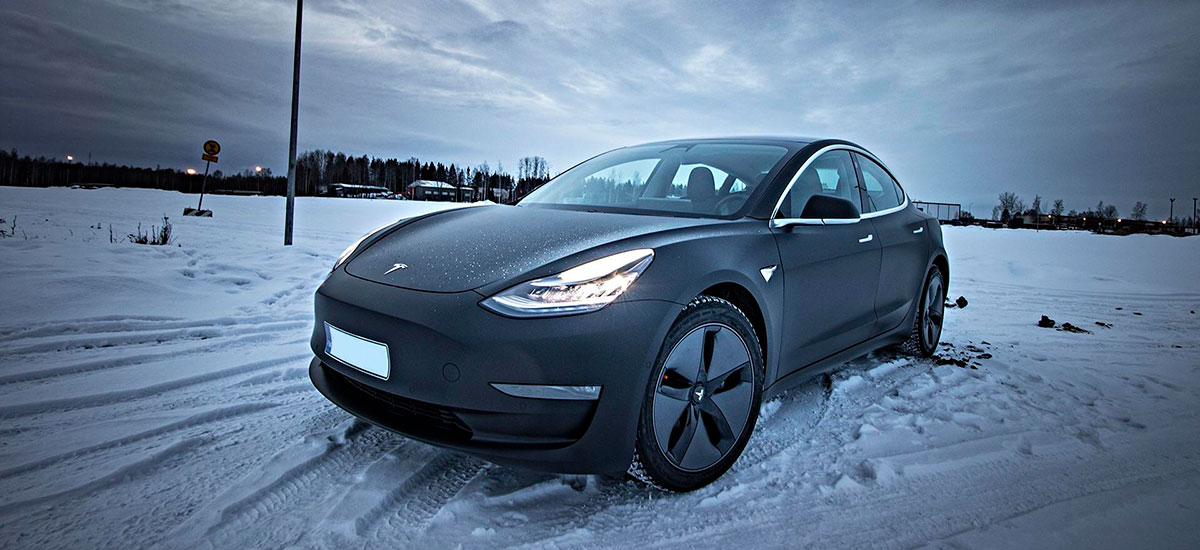 Matte Black Tesla Model 3 in snow