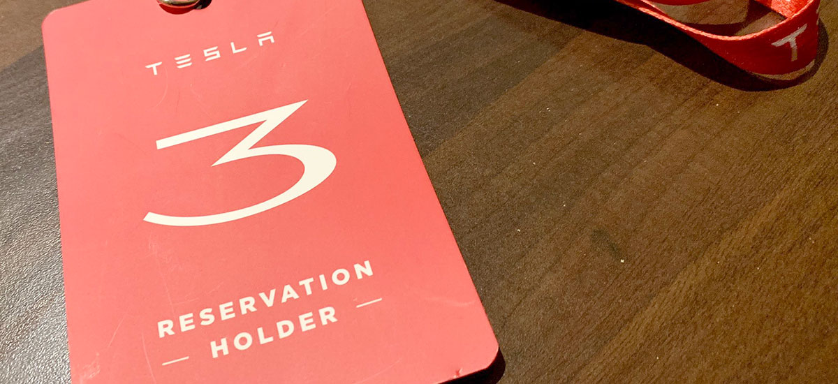 RHD Tesla Model 3 reservation holders card for visiting a Tesla Store in the United Kingdom