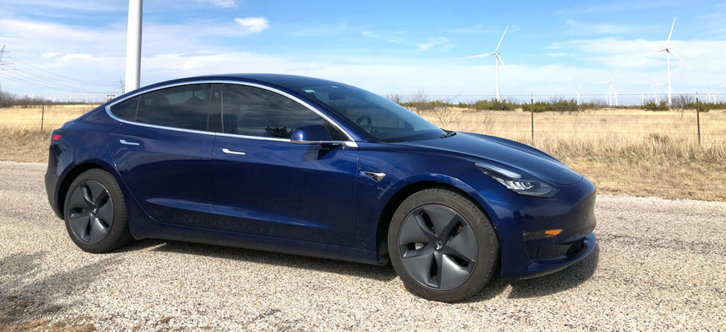 Tesla Model 3 in Texas - Windmills in the background