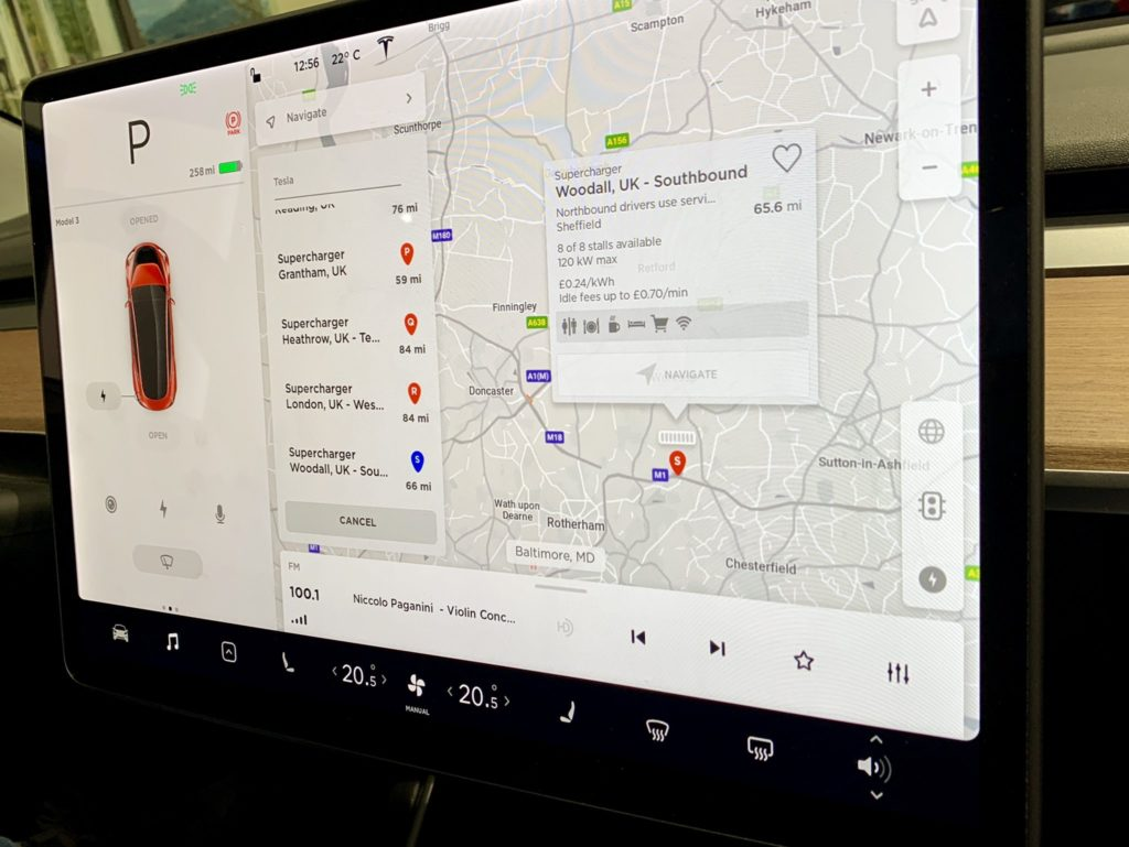 Tesla Model 3 Center Touchscreen with United Kingdom maps and charging information display.