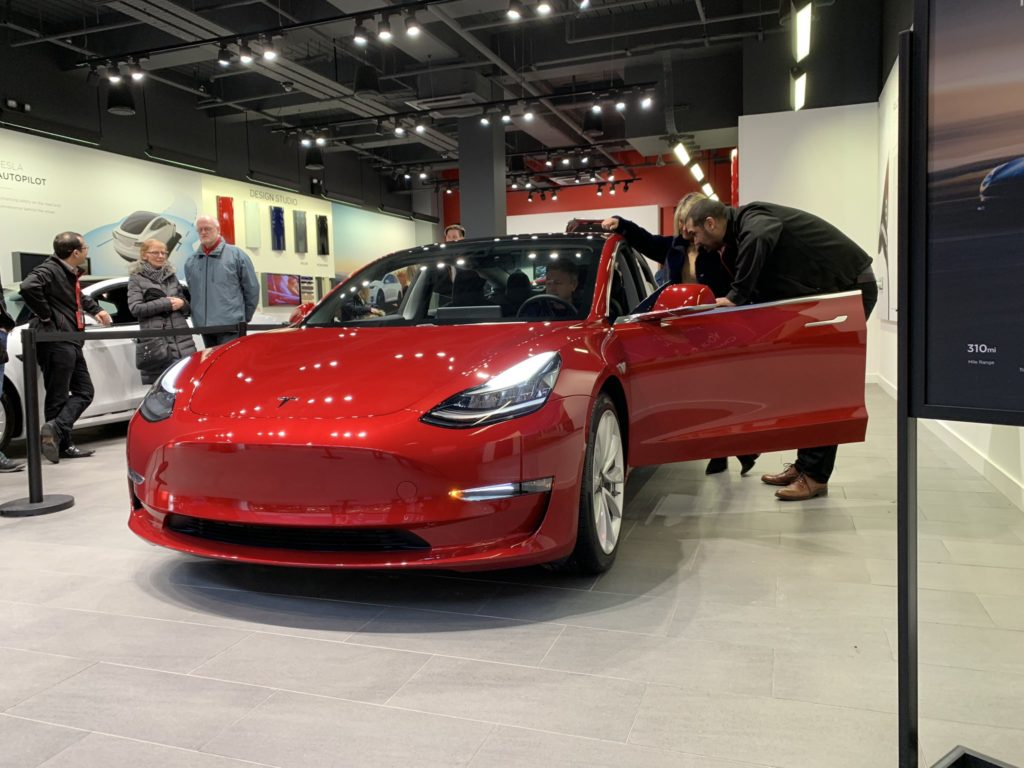 Red Tesla Model 3 on display in the UK - Front View