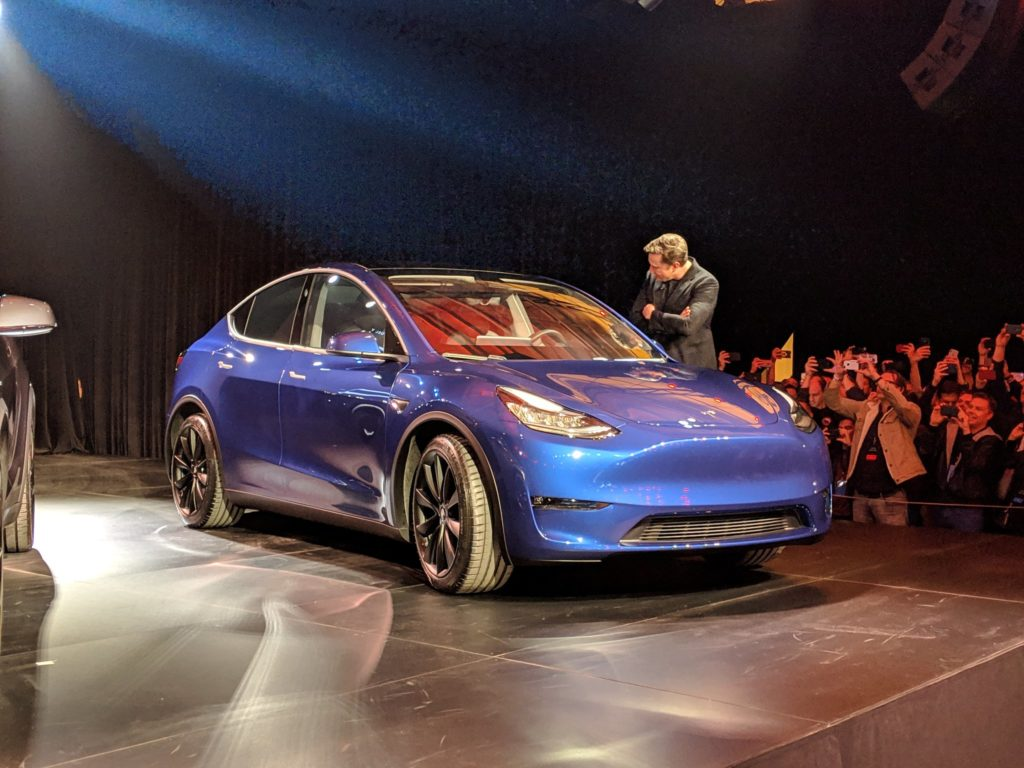 Elon Musk checks out the Tesla Model Y at the unveil event