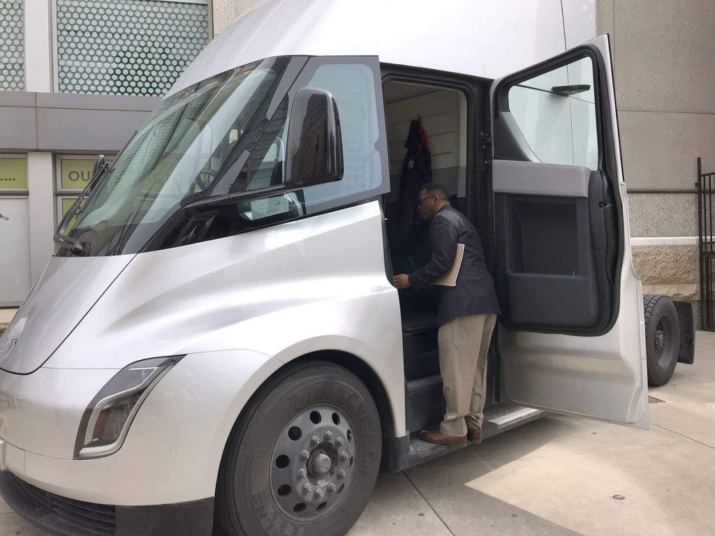 Tesla Semi Truck in silver color on display in Sacramento, CA - Side view with door open