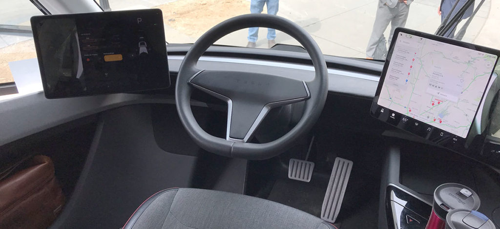 Tesla Semi interior photo showing steering and dual screens
