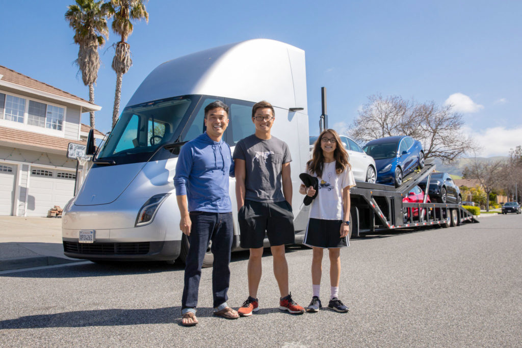 Happy Tesla customers taking photos with the Semi Truck
