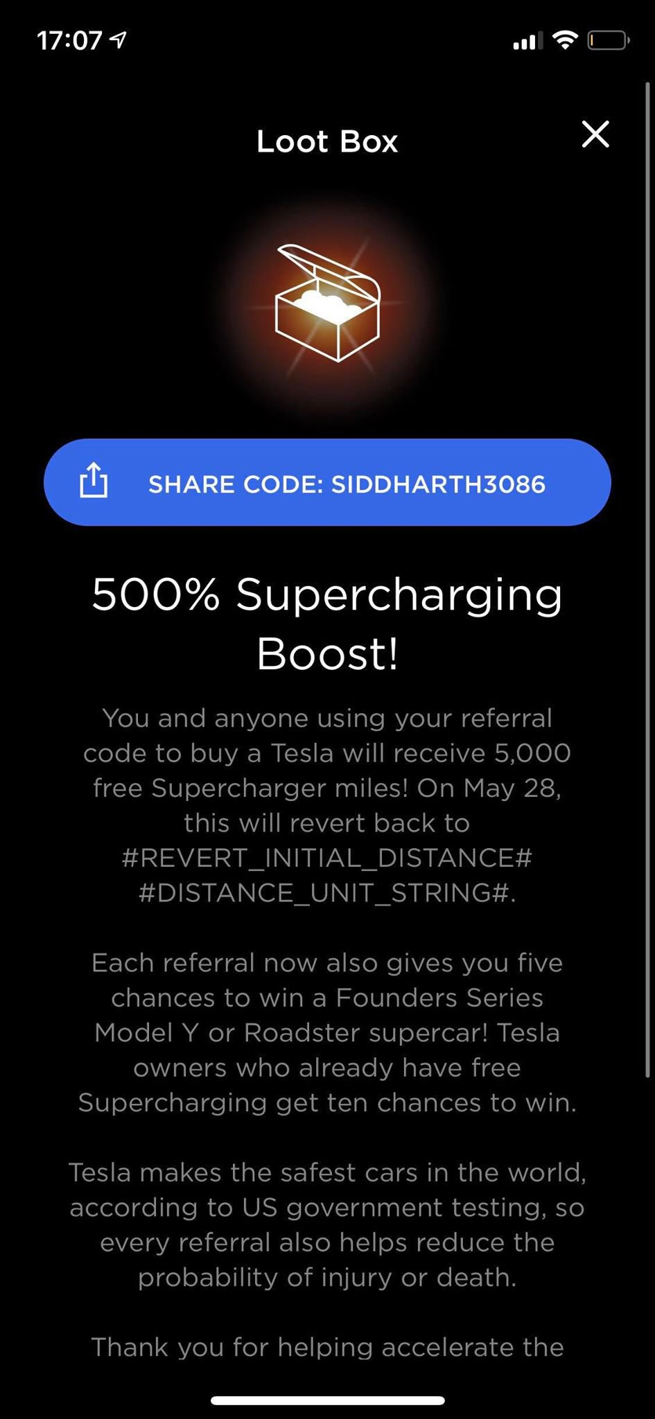 Tesla Loot Box message mentioning the details of the 5,000 Free Sueprcharging miles and other perks of the new referral program.