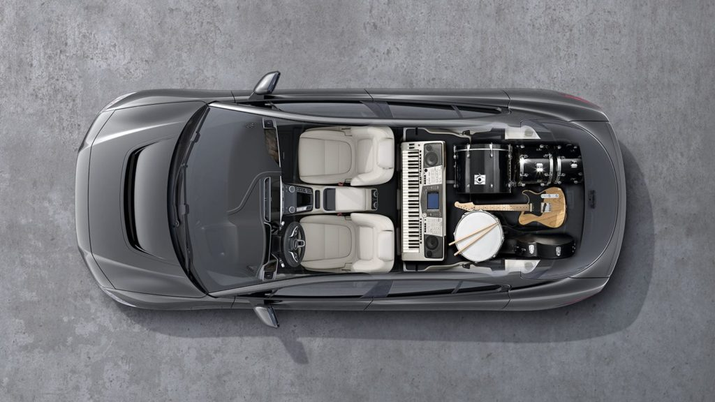 Jaguar I-Pace interior space shown in aerial shot while the music instruments stored in the vehicle.