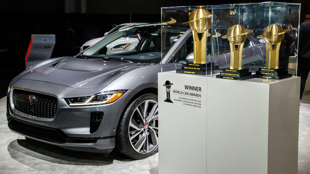 Jaguar I-Pace standing besides the awards at the 2019 New York International Auto Show