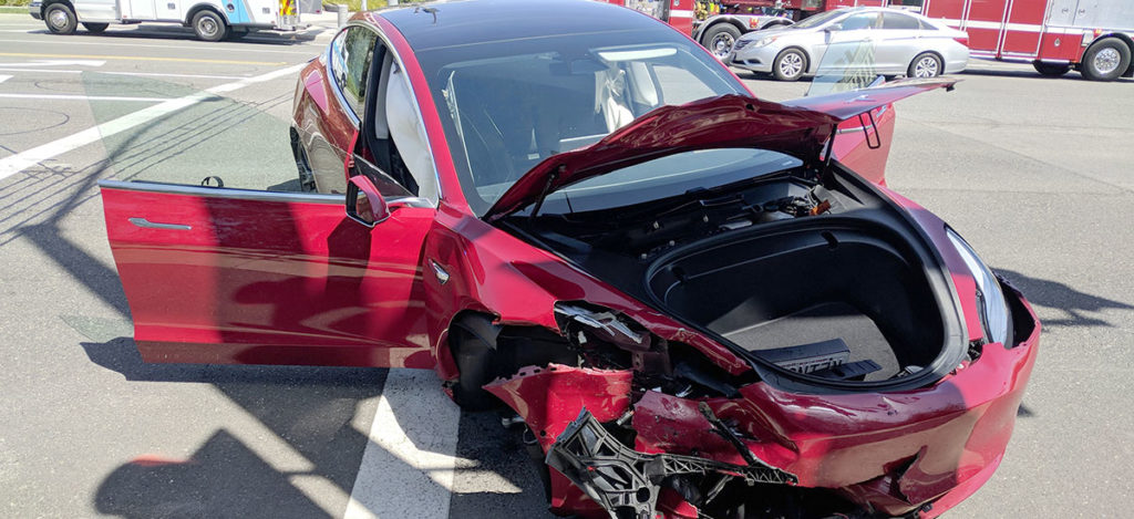 Tesla Model 3 crash in California, driver walks out unharmed.