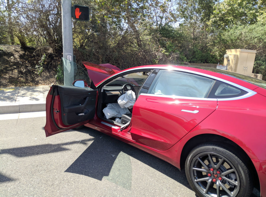 Red Tesla Model 3 crashes in California - other side door open rear view