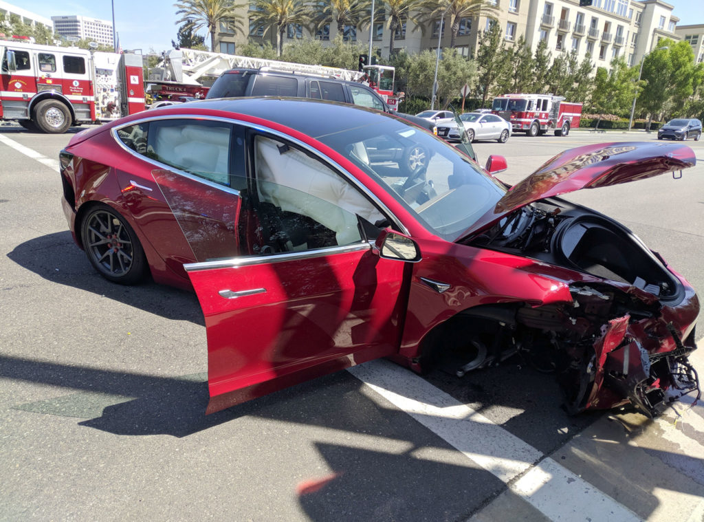 Red Tesla Model 3 crash - crashed side's view, left fender, wheel and headlight totally smashed