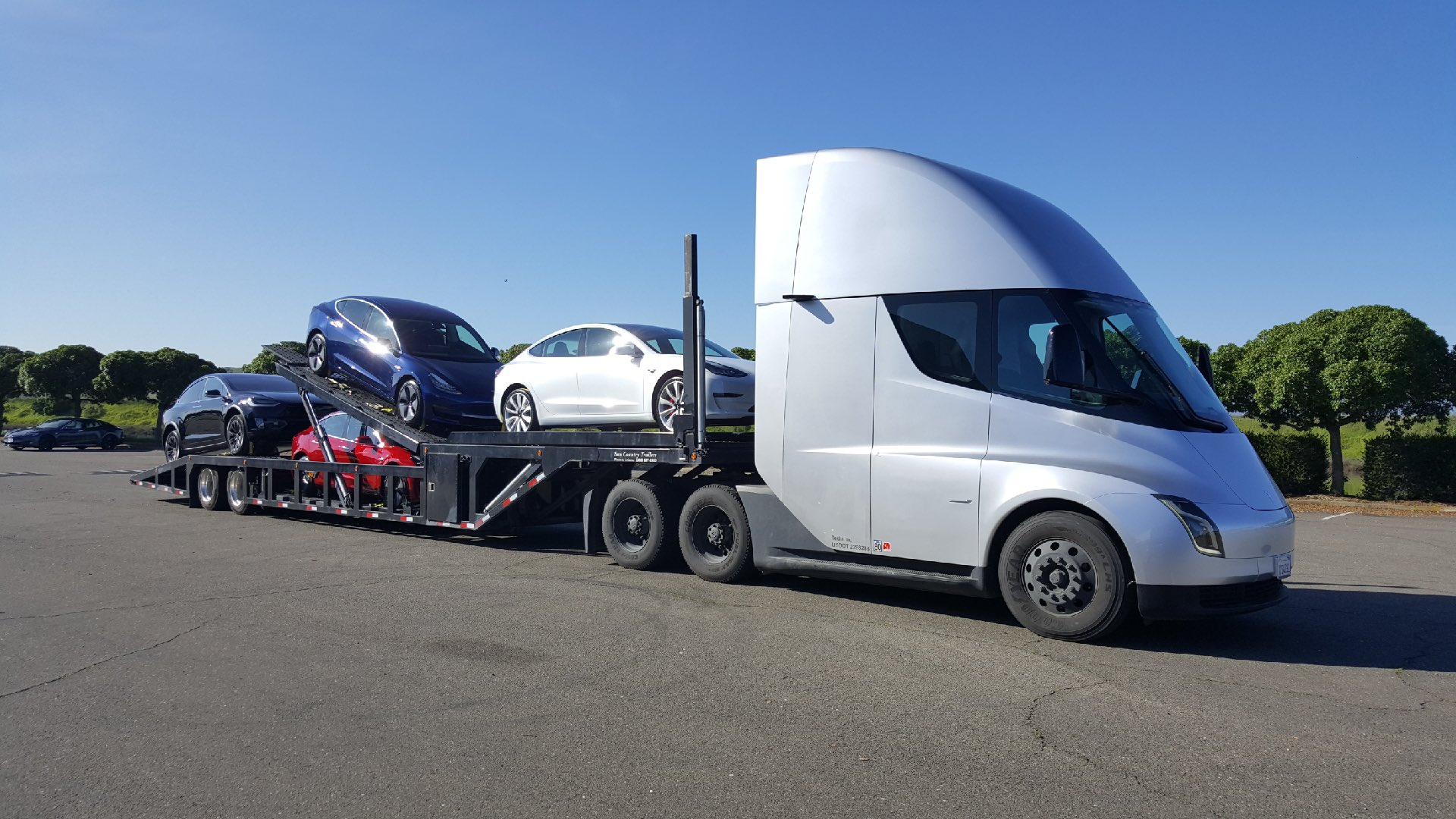 Tesla Semi Truck carrying Tesla cars on its carrier trailer.