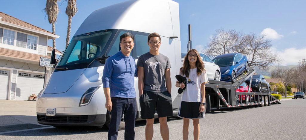 Tesla Semi Truck delivering cars to happy Tesla customers