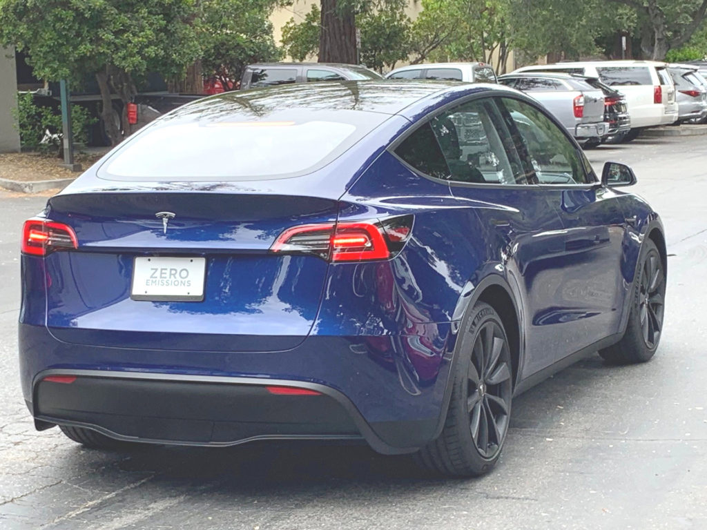 Blue Tesla Model Y prototype spotted in the wild being filmed for an upcoming video.