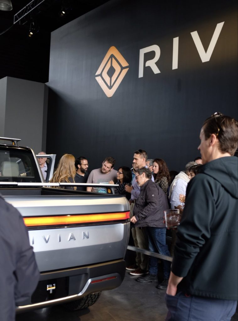Reservation holders take a close look at the Rivian R1T Pickup Truck at the Classic Car Club Manhattan.