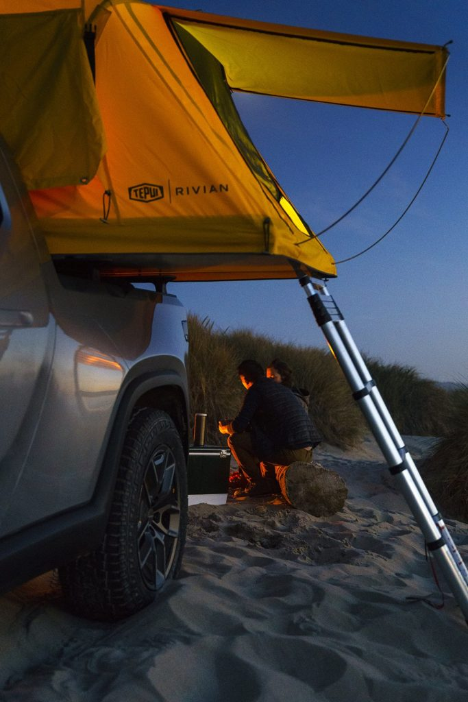 Camping in the R1T Pickup Truck with a large tent.