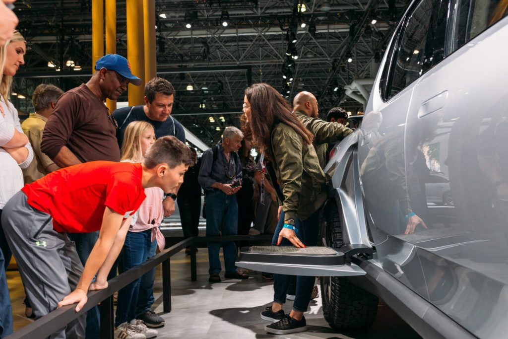 New York Auto Show visitors looking at the 'gear tunnel' of the Rivian R1T Pickup Truck.