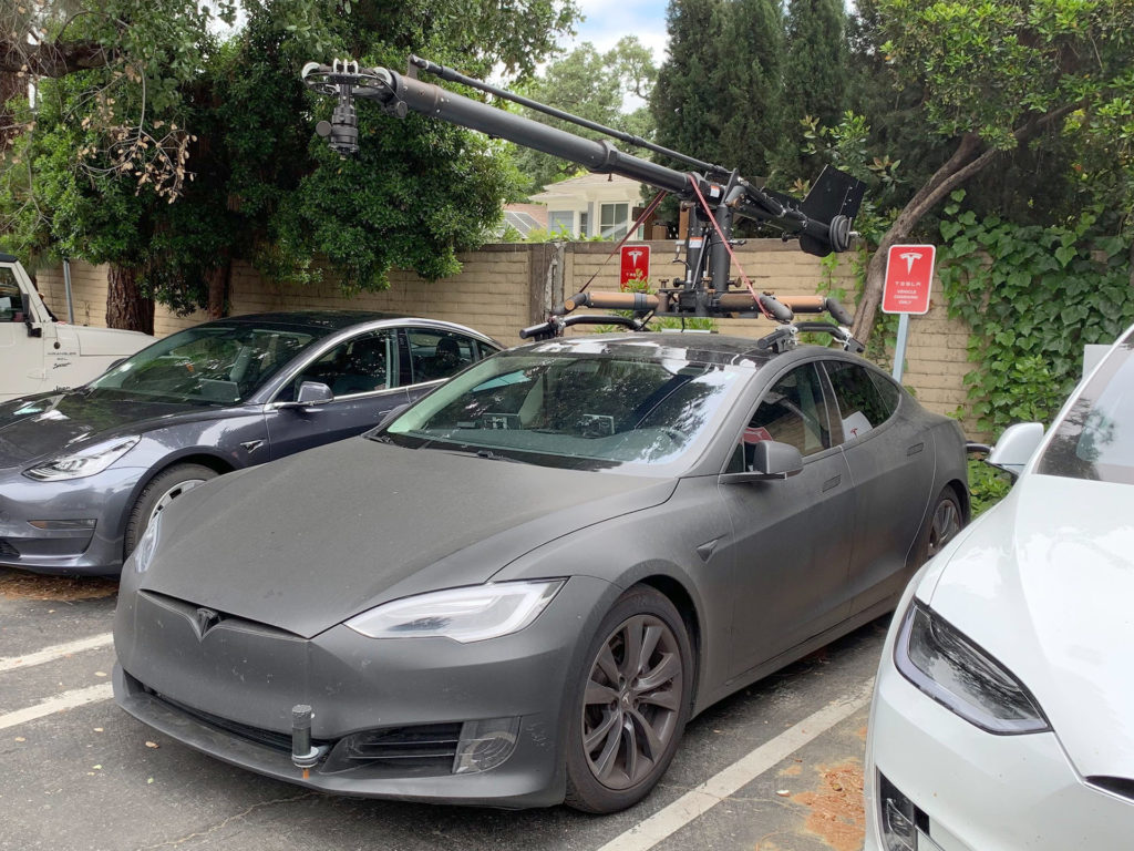 Matte gray Tesla Model S camera car that was chasing Model Y for filming.
