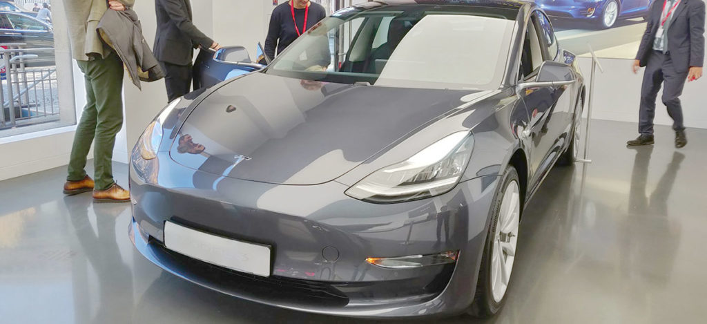 Tesla Model 3 in midnight silver metallic color in a Tesla Showroom.