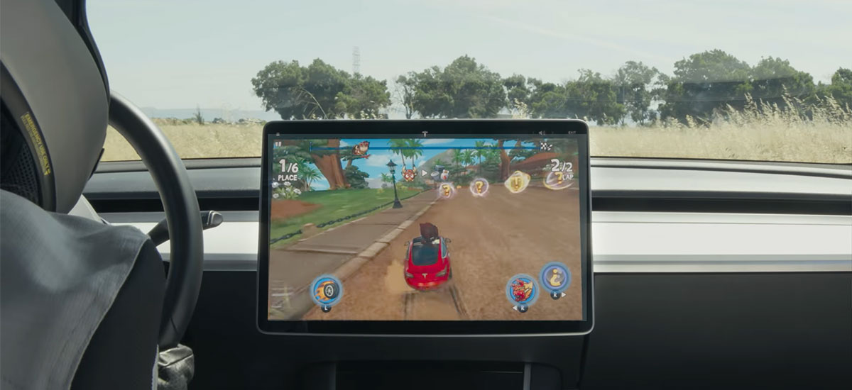 Playing Beach Buggy 2 video game in a Tesla Model 3