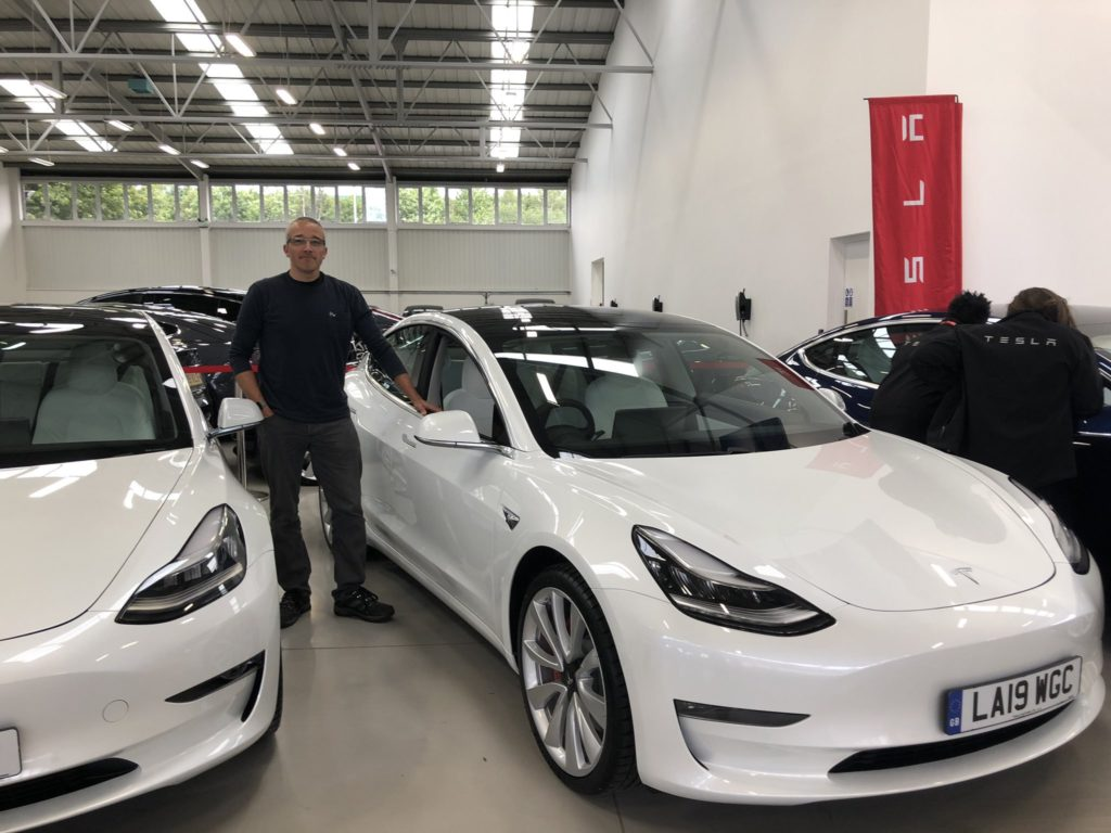 Two white RHD Tesla Model 3s at the Tesla London Showroom.