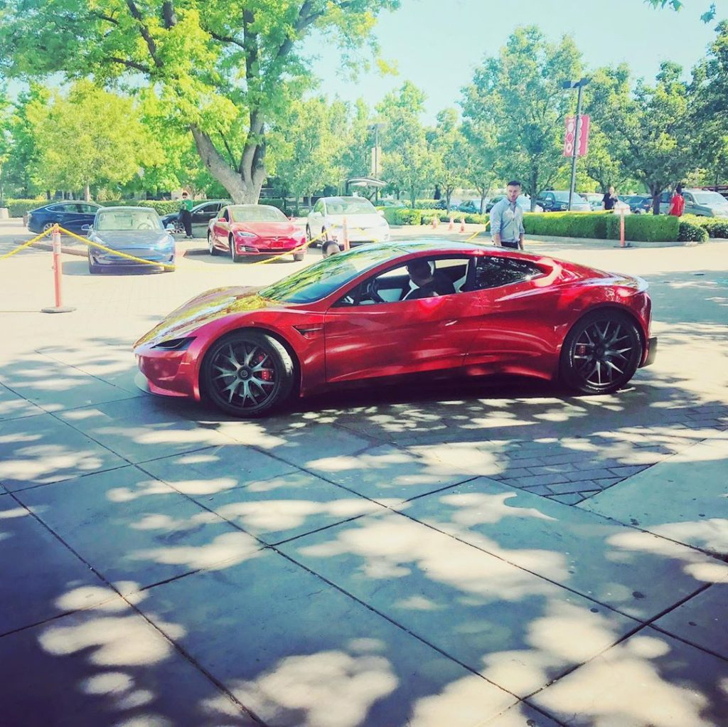 Red Tesla Roadster at the 2019 Tesla Shareholder Meeting - Side View Profile from a distance
