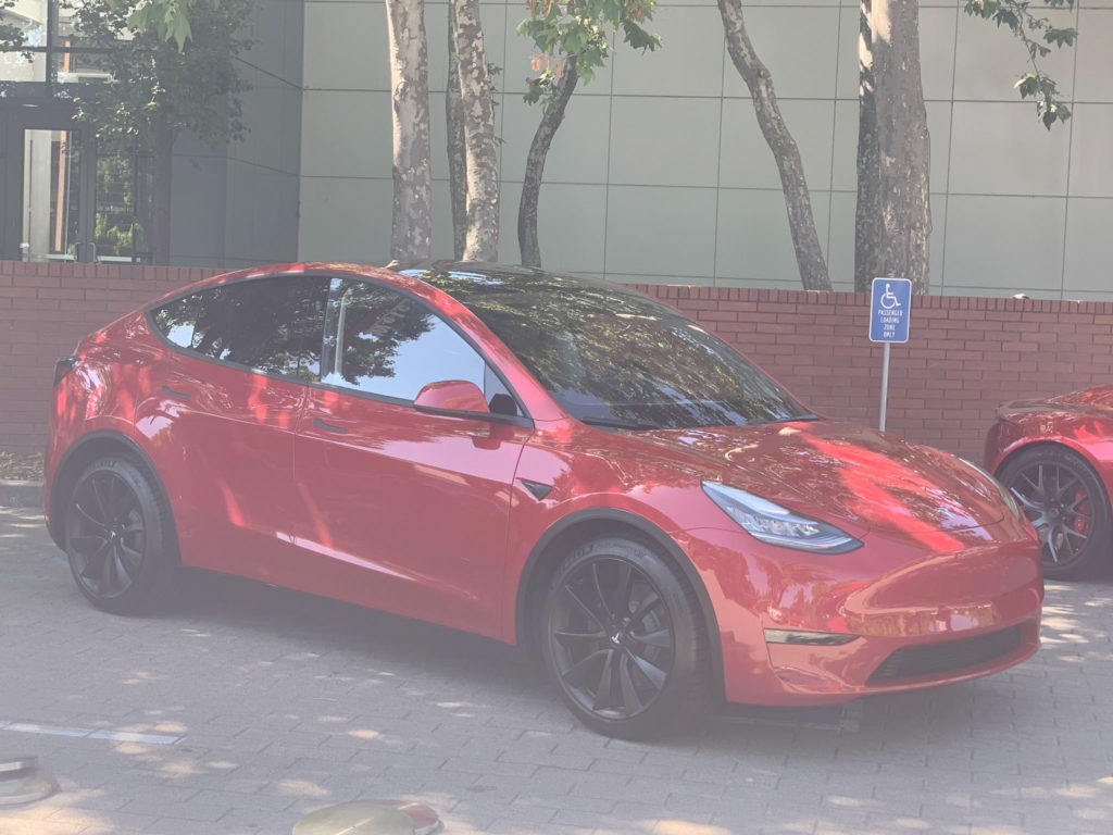 Red Tesla Model Y at the 2019 Tesla Shareholder Meeting - Front View
