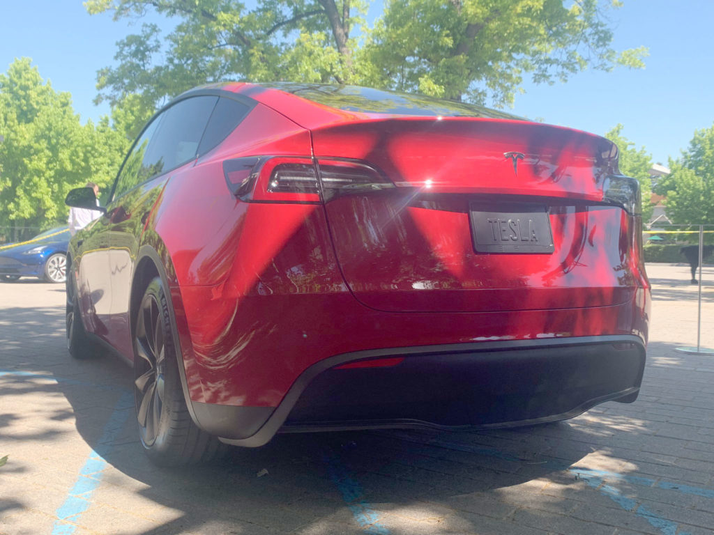 Red Tesla Model Y at the 2019 Tesla Shareholder Meeting - Rear View