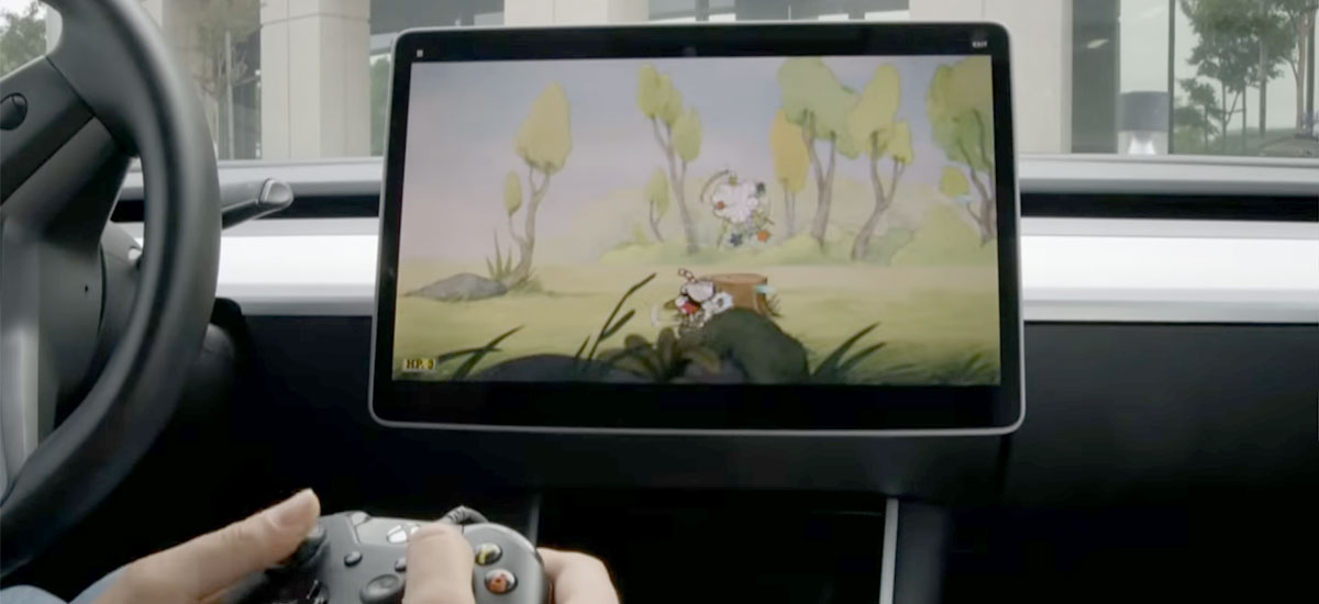 Playing Cuphead video game on a Tesla Model 3
