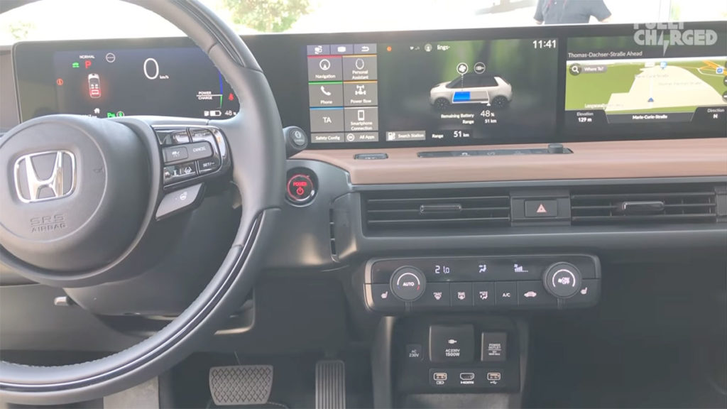 Honda e dashboard: touchscreens, navigation, climate options, power outlets.