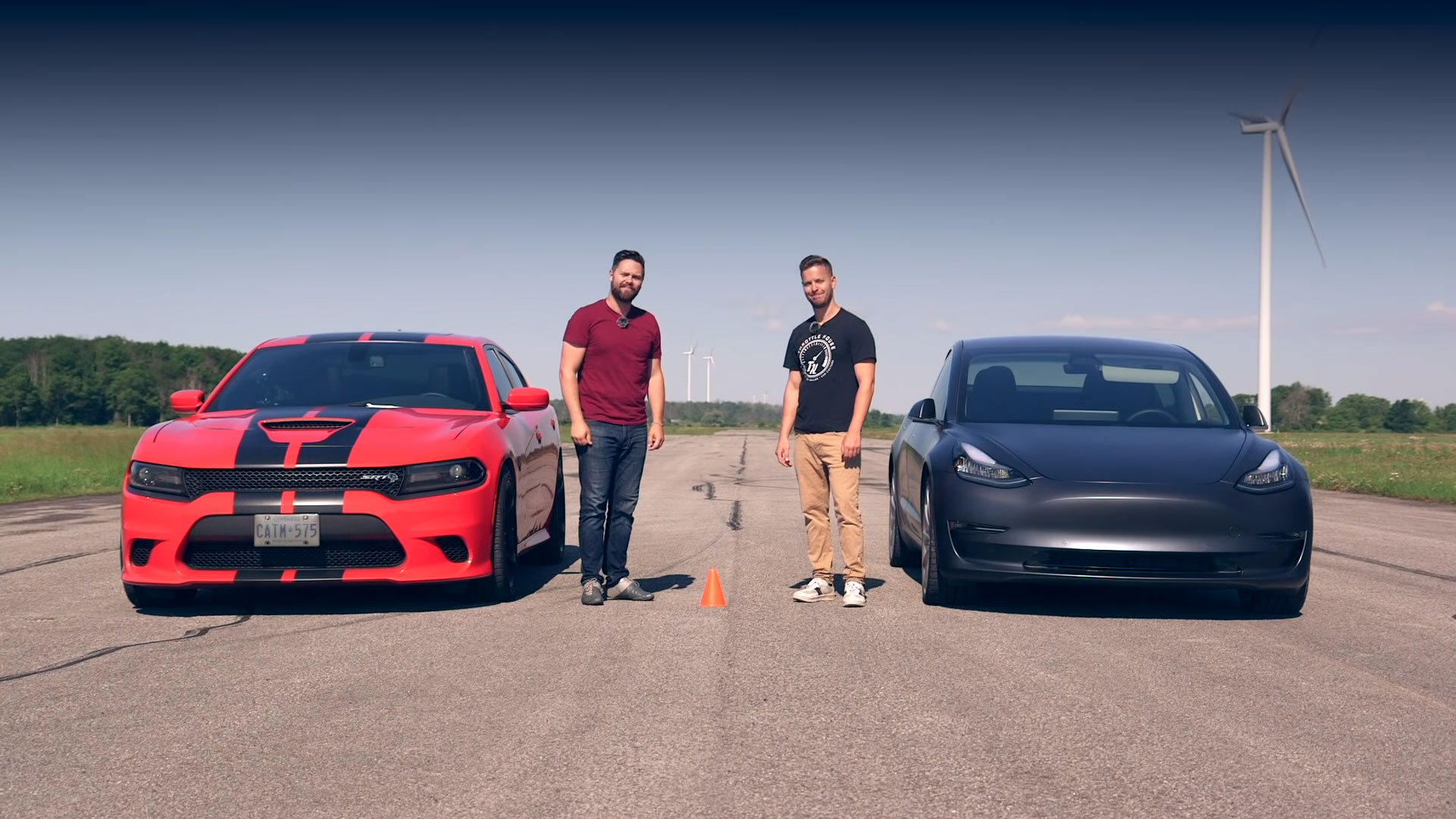 Tesla Model 3 Performance and Dodge Challenger SRT Hellcat ready for the drag race.