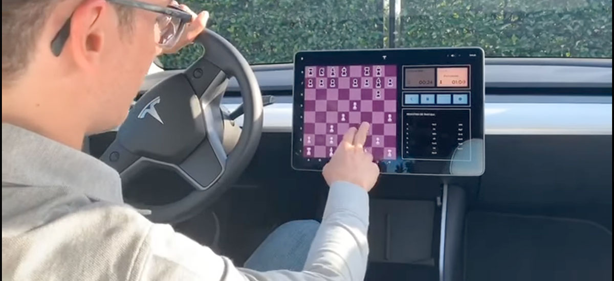 Fabiano Caruana challenges a Tesla Model 3 to a game of chess.