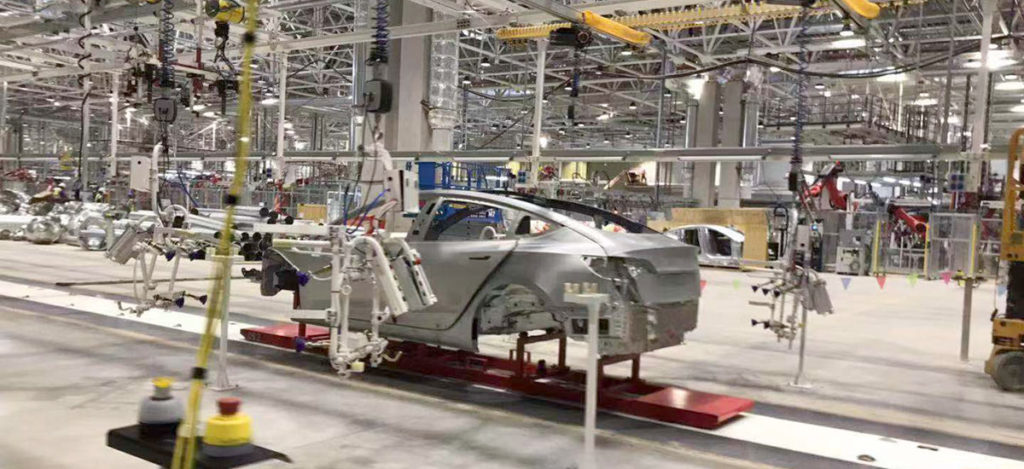 A Chinese Tesla Model 3 on the Tesla Gigafactory 3 assembly line.