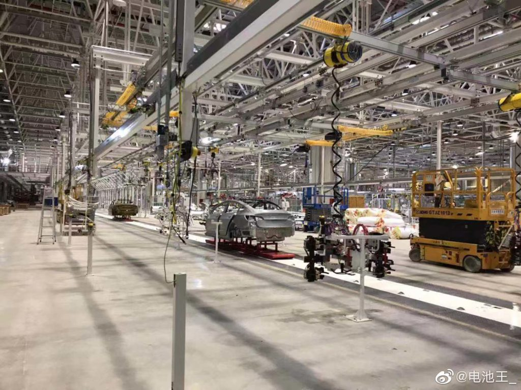 Chinese Tesla Model 3 electric cars on the Tesla Gigafactory 3 assembly lines.
