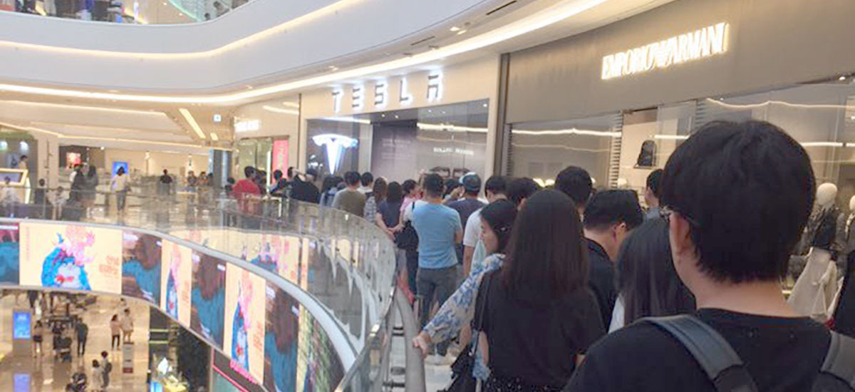 Tesla Model 3 launched in South Korea, Tesla customers and enthusiasts rush towards the showrooms to get a glimpse.