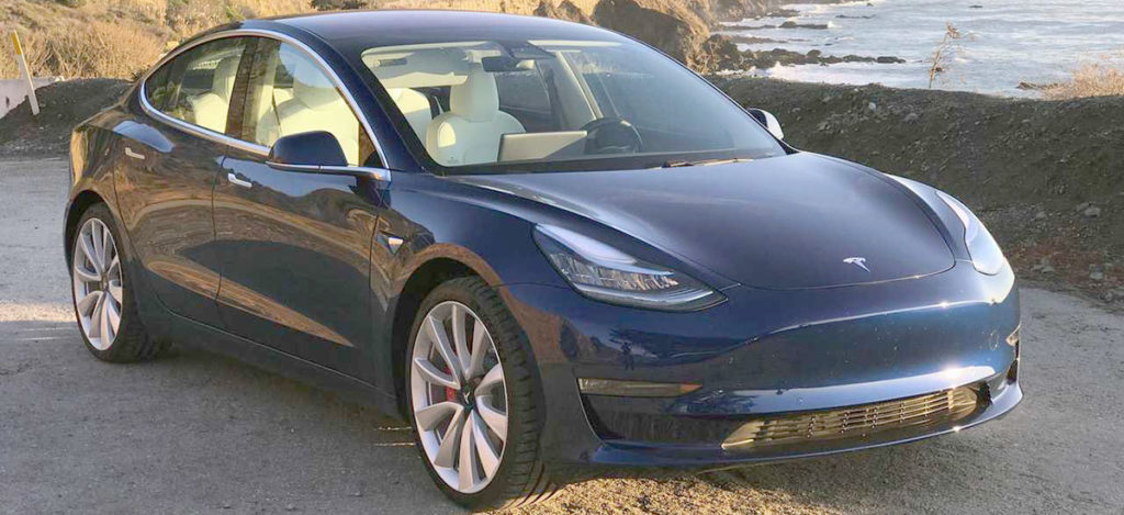 Tesla Model 3 in blue color closeup shot.